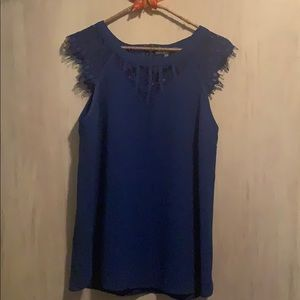 Blue blouse with decorative neck and sleeves